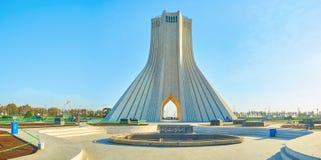 Panorama of Azadi Tower in Tehran, Iran. TEHRAN, IRAN - OCTOBER 25, 2017: Panorama of Azadi Square with its main landmark The Azadi Tower in the middle of small stock image