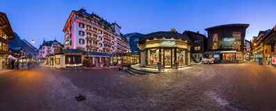Panorama of Bahnhofstrasse and Mont Cervin Palace in the Evening stock photo