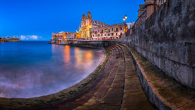 Panorama of Balluta Bay and Church of Our Lady of Mount Carmel Stock Photo