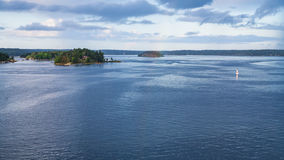 Panorama of Baltic Sea with green island Royalty Free Stock Image