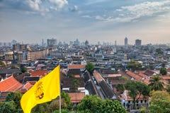 Panorama of Bangkok with buddhist flag Stock Photos