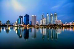 Panorama of Bangkok city downtown at twilight with reflection sk Stock Photos