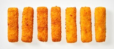 Panorama banner of crumbed golden fish fingers sticks stock image