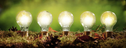 Panorama banner with five glowing light bulbs Stock Images