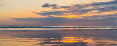 Panorama, Banner, long format of Sunset on the Kuta beach with r. Eflection in the water on the island of Bali stock images