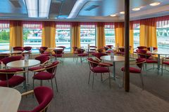 Panorama of bar-restaurant aboard the Cruise Ship. Ships bar has panoramic windows and bar for relaxation Royalty Free Stock Photos
