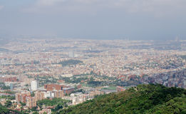 Panorama on Barcelona city at hot summer day from Montjuic castle. Catalonia, Spain Royalty Free Stock Photo