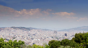 Panorama of Barcelona cityscape with Sagrada Familia in foreground and sea in background. Barcelona, Catalonia, Spain, Europe. Royalty Free Stock Image