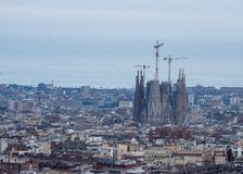 Panorama of Barcelona Spain featuring the construction of the Sagrada Familia Cathedral. Spain, Barcelona - June 2018: Panorama of Barcelona Spain featuring the royalty free stock photography
