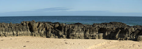 Panorama of  basalt rocks at Ocean Beach Bunbury  Western Australia Stock Images
