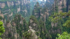 Mountain Formations In Form High Rocky Stone Pillars In Zhangjiajie Forest Park. Panorama from base of rock to the top, as a result of corrosion formed mountain stock footage
