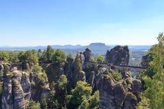 Panorama with Bastei Bridge, Neurathen Castle and table mountain Lilienstein in Rathen, Saxon Switzerland Stock Photos