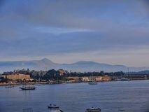 Panorama of the Bay at Corfu town on the the Greek island of Corfu. The city of Corfu stands on the broad part of a peninsula, whose termination in the Venetian Stock Photos