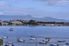 Panorama of the Bay at Corfu town on the the Greek island of Corfu. The city of Corfu stands on the broad part of a peninsula, whose termination in the Venetian Stock Photo