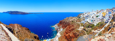 Panorama of bay with port and colorful houses in Oia town, Santorini island Stock Images