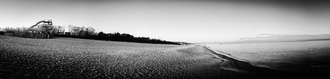 Panorama on the beach. Artistic look in black and white. Stock Images