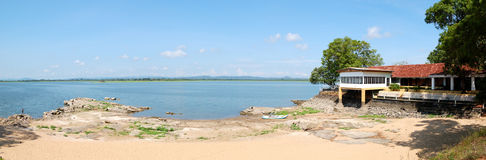 The panorama of beach at lake and restaurant Stock Photos