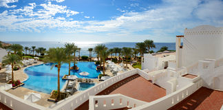 Panorama of the beach at luxury hotel Royalty Free Stock Photos