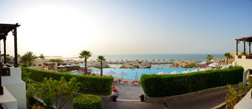 Panorama of the beach at luxury hotel in sunset Stock Photo