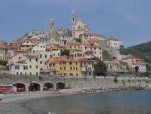 Panorama of Cervo. Panorama from the beach of the medieval village of Cervo, Liguria, Italy Royalty Free Stock Images