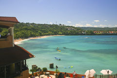 Panorama of the Beach at Sosua, Dominican-Republic. A panorama of the beach on the bay at Sosua, Dominican Republic with a resort in the foreground and the Stock Photography