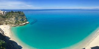 Panorama of the beach of Tropea, italy. Panorama of the white sand beach and turquoise blue sea of the city Tropea in Reggio Calabria, Italy stock image