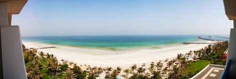 The panorama of beach and turquoise water of the luxury hotel Royalty Free Stock Photography