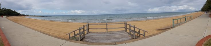 Margate and Sutton& x27;s Beach panoramic. Panorama of Beach and walking path with wooden stairs to sand Stock Image