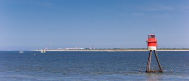 Panorama of a beacon near Borkum island. Germany stock photos