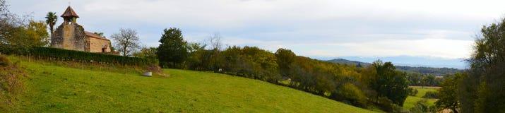 Panorama of Bearn de Gave countryside with Chapelle de Caubin XI Royalty Free Stock Photo