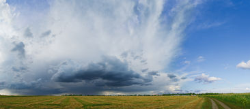 Panorama of the Beautiful Autumn Field under Stormy Sky Royalty Free Stock Images