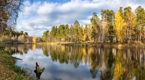 Panorama of beautiful autumn landscape in a forest with a lake, Russia, Ural Stock Photos