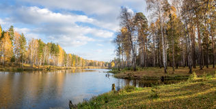 Panorama of beautiful autumn landscape in a forest with a lake, Russia, Ural Royalty Free Stock Photography