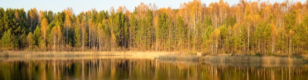 Panorama of beautiful autumn landscape on the lake, Russia, Ural,. Panorama of beautiful autumn landscape with lake and forest on the banks, Russia, Ural Stock Images