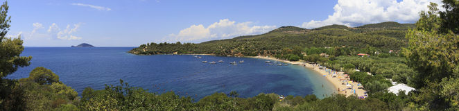 Panorama of beautiful bay of Aegean Sea with sandy beach. Stock Image