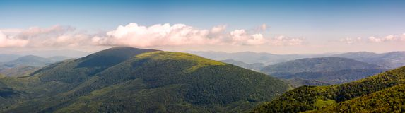 Panorama of beautiful Carpathian mountains. Lovely forenoon summer landscape viewed from top of a hill Stock Images