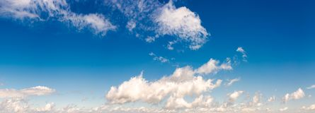 Panorama of beautiful cloudscape on a blue sky. Wonderful summer weather background Stock Photo