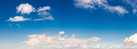 Panorama of beautiful cloudscape on a blue sky. Wonderful summer weather background Stock Photography