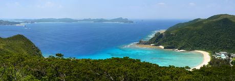 Panorama of a beautiful cove and coral reef at Tokashiku Beach on Tokashiki Island in Okinawa, Japan Stock Photos