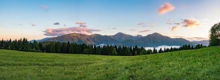 Panorama of beautiful dawn with mountains ridge Stock Photos