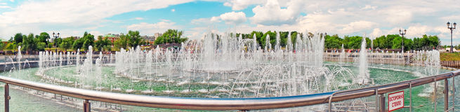 Panorama beautiful fountain against the blue sky with clouds Stock Images