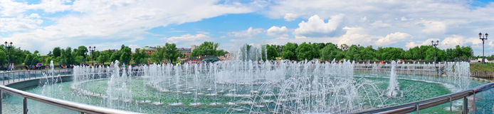 Panorama beautiful fountain against the blue sky with clouds Royalty Free Stock Photos