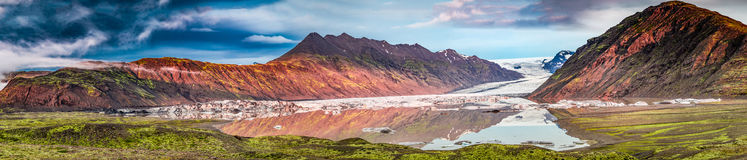 Panorama of beautiful glacier and lake at sunrise in Iceland Stock Images