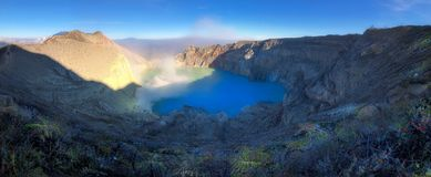 Kawah Ijen at Sunrise. Panorama beautiful landscape with dry tree branch view of Kawah Ijen at Sunrise. The most famous tourist attraction in Indonesia royalty free stock images