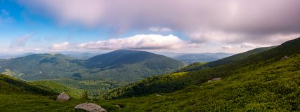 Panorama of beautiful mountain landscape. Beautiful scenery with clouds coming over the hills Royalty Free Stock Image