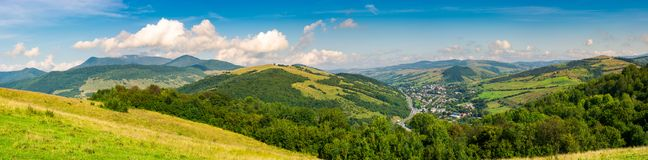 Panorama of beautiful mountainous rural area. Village down in the valley. agricultural fields on hills Royalty Free Stock Image