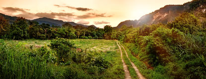 Panorama of beautiful mountains and natural attractions in sunset time, Khao Sok National Park, Thailand. Beautiful evening landscape in sunset time, path in Royalty Free Stock Images