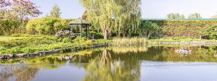 Panorama of a beautiful place to relax on the lake in Mezhyhirya Park near Kiev. royalty free stock images