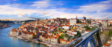 Panorama of beautiful Porto over sunset - view with famous bridge of Luis, Portugal. Beautiful Porto town, panoramic view, Portugal royalty free stock image