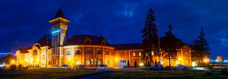 Panorama of beautiful railway station building at night. Uzhgorod, Ukraine - SEP 28, 2008: Panorama of beautiful railway station building at night Royalty Free Stock Photo